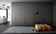 Contemporary wardrobe / in wood / with swinging doors PLA by Fernando Salas and Jordi Dedeu CARRE furniture