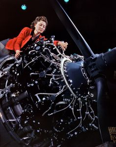 Douglas aircraft engine installer. Beautifully intricate engine parts! October 1942.