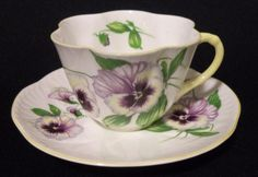 Shelley Dainty Pansy Tea Cup and Saucer by EnchantedChinaGarden on Etsy https://www.etsy.com/listing/219093257/shelley-dainty-pansy-tea-cup-and-saucer