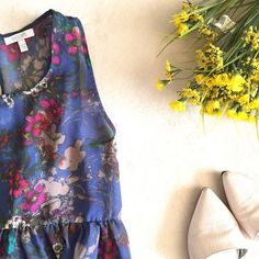 Fun floral summer dress Chiffon floral dress. Body hugging underdress, so it's not see-through.  Ties in the back. Delia's Dresses Mini