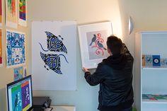 Greg Straight hanging an art print in his studio. From an interview with Greg, on our blog: http://nzartprints.co.nz/2013/10/artist-interview-meet-greg-straight-illustrator/  See all Greg Straight prints here: http://www.endemicworld.com/artists/greg-straight-art-prints/