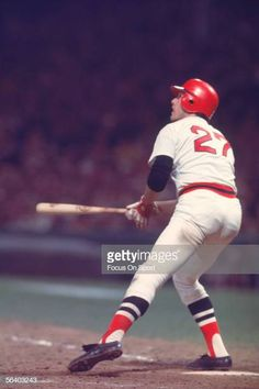 Hall of Fame member Carlton Fisk of the Boston Red Sox hits a home run off the foul pole in the inning of game six against the Cincinnati Reds. Red Sox Baseball, National League, Cincinnati Reds, Boston Red Sox, Thing 1 Thing 2, Socks, Football, Pictures, Soccer