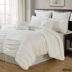 Chic and dimensional, this comforter set features a sophisticated ruched cotton construction. The billowing, soft comforter lends elegance to any bedroom decor and the set is conveniently machine washable.