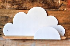 CLOUD SHELF Children's Collection   This eco friendly cloud shelf will look gorgeous on a child's bedroom wall. Handcrafted by our expert craftsmen from a combination of 100 year old reclaimed and new timber.   Dimensions: 515mm long x 265mm high x 105mm deep   Fixing: Two countersunk holes to allow you to screw it to the wall (we've used white button head screws in the picture - available at hardware stores)   Handcrafted on the Sunshine Coast by RAW