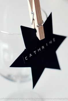 Star or other shape, directs guests to their tables then with the help of a mini clothes pin becomes a drink glass marker.