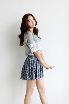 Very cute grey shirt with lace detailing and the patterned skirt.