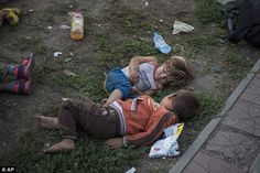 Innocence: Syrian children sleep in the park in the early hours of Sunday before setting o...