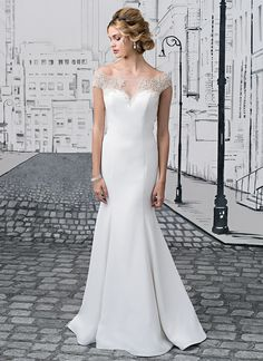Rich beading at the neckline continues to the back of the gown to trim the illusion keyhole back. This fit and flare gown is completed with a Sabrina neckline, couture seaming, and buttons to end of chapel length train. https://www.justinalexanderbridal.com/wedding_dresses/8878