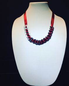 A personal favorite from my Etsy shop https://www.etsy.com/listing/260467527/red-ribbon-bib-necklace