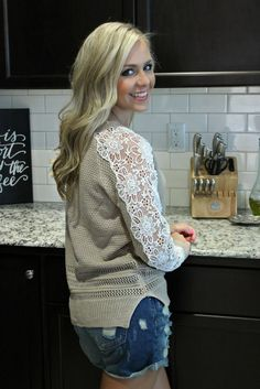Get lazy, get cozy. This adorable sweater has got your back. Light mocha colored…