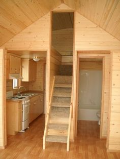 "Tiny house with built in stairs/storage underneath. I like this because it's a loft bedroom, but with more separation and proper stairs. AND the only space that is ""wasted"" is the frost 3 or maybe 4 steps. The remaining under stairs space makes really great storage, and with the bathroom on the other side some of that area could open into the bath and some into the kitchen."