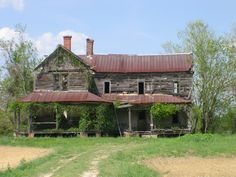 weathered farmhouse....I wish old houses could talk, I would love to fix this up and listen to the stories!
