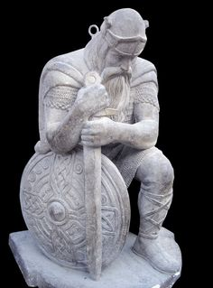 Ancient kneeling Norse warrior statue from Norwegian church