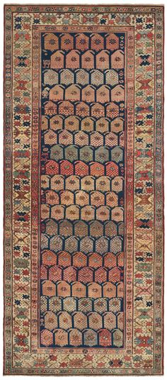 Caucasian Karabagh, 5ft 1in x 11ft 2in,  Late 19th Century.     A succession of evocatively hued botehs (an agricultural symbol representative of sprouting seeds) cascades across the wide reserve of this distinctive Caucasian Karabagh antique rug, guiding the eye along its full corridor carpet length. Charmingly stylized motifs dovetail seamlessly to create a unified composition, where diminutive ornaments add great visual interest through the Caucasian carpet's abundant detail.