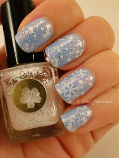 Snowflake Nails by I Feel Polished. Used: Essie Bikini So Teeny (2 coats) with 1 coat of Models Own Indian Ocean microglitter, followed by 2 coats of Sonnetarium Snowfall on all but the accent nail. Ring finger: Shany stamp with Zoya Purity, and a bit of random from Snowfall around the design.