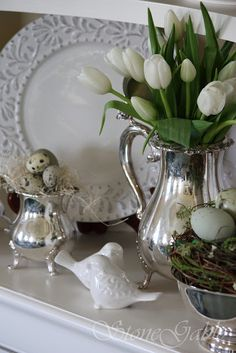Tulips in the silver pitcher....so doing this