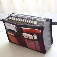 All in One Purse Organizer. This bag is designed to keep you organized while on the go, for school, travel, for your purse, and more!  The multiple spacious compartments can hold just about anything from notebooks, wallet, mobile device, makeup, pens and pencils, and more.