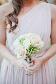 Love the dress in the background, the bouquet is stunning too...<3