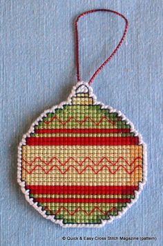 This pattern from Quick & Easy Magazine was perfect for creating a hangable Christmas tree decoration in a variety of colours. I made this one in cross stitch on14ct plastic canvas square using whatever stranded cotton threads I had that I thought look good together. Then I cut very carefully around the bauble leaving one line of canvas intact all round, which I oversewed in white perle.