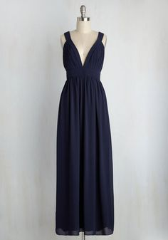 The go-to gal of the gala, you maintain a magnificent look in this navy blue maxi dress while overseeing a smooth operation. Ever-so-elegantly finessed with a plunging neckline, pintucked bust, pleated waist, and tied open back, this beautiful chiffon gown brings an elegance to the event that will be remembered for years to come!