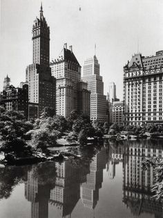 Vintage Shot: Manhattan Below Central Park  This view is today still a great one.  Reblogging: skyscraper:    Fifth Avenue skyscrapers from Central Park's Pond. May 1933.Photo: Samuel Gottscho  via wirednewyork.com