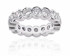 This Unique Bezel Set Diamond Eternity Wedding Band Is Adorned With G/H Color And VS 1/2 Clarity Round Diamonds Available In Mulitiple Carat Weights In Your Choice Of 14K & 18K White, Yellow Or Rose Gold, Platinum and Palladium