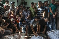 The Year in Pictures, 2014 - NYTimes.com ABALIYA, GAZA STRIP 08/04/2014 Palestinians mourned a family that was killed in an Israeli airstrike. Sergey Ponomarev for The New York Times