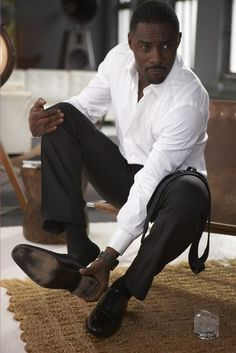 Elba gets comfortable on the set of his first ever ESSENCE cover shoot in 2009.