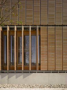 Pivot screening on the outside of the Aalen University extension by MGF Architecten Wooden Screen Door, Diy Screen Door, Wooden Facade, Timber Screens, Timber Cladding, Window Screens, Cladding Ideas, Window Shutters, External Cladding
