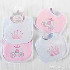 Sometimes, even little princesses need help at meal time. On these adorned bibs, a darling princess pink crown and a charming pink and white carriage keep baby girl's frilly frocks ready for the ball. | Little Princess Bibs