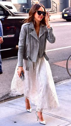9 March Jessica Alba gave her girly dress an edge by teaming it with a suede biker jacket as she ran errands in New York.