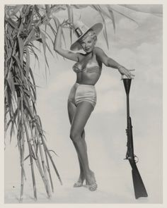 This looks like a dangerous way to hold a rifle. | 13 Bizarre Vintage Thanksgiving Pinups