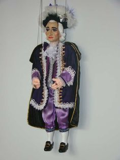 Amadeus Mozart puppet. A original Czech puppet marionette is controlled with the help of threads, wire and a special cruciform rocker (lever).