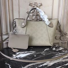 Buy LOUIS VUITTON Replica of top quality from China - Hina PM Mahina Leather is exclusively of top original order quality. Handbags On Sale, Luxury Handbags, Louis Vuitton Handbags, Purses And Handbags, Louis Vuitton Monogram, Designer Handbags, Designer Bags, Plain Canvas, Mein Style