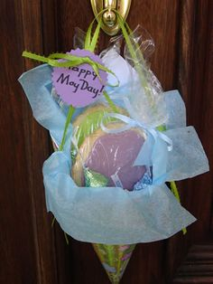 May Day Baskets, made with wrapping and construction paper, shaped into a cone to hold treats for friends!