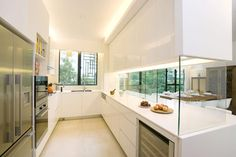 semi open-plan kitchen design, aesthetically pleasing yet functional. Sliding glass panels can close up the kitchen to avoid smoke and smells from escaping in a small home Closed Kitchen Design, Open Kitchen Layouts, Kitchen Layout Plans, Open Plan Kitchen, Interior Design Kitchen, Kitchen Pass, Kitchen Oven, Kitchen Small, Kitchen Designs