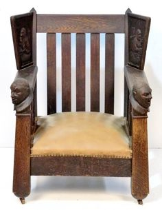 """SHOP OF THE CRAFTERS, attribution, mission oak armchair, arm grips and winged panels with carved monks, 39""""h. x 32""""w. x 29""""d"""