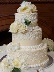 White butter cream round wedding cake photo by Bee