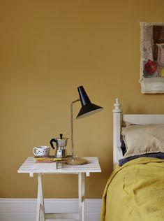 Mustard yellow paint 'Humpty Dumpty' by Earthborn on a bedroom wall