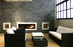 Interior, Contemporary Natural Stone Wall Living Room Design With Black Puffy Wicker Sofas And Fireplace Minimalist Style Ideas: Awesome Natural Stone Movement for Natural Home Interior Design Ideas Stone Veneer Fireplace, White Fireplace, Fireplace Wall, Modern Fireplace, Luxury Homes Interior, Home Interior Design, Interior Decorating, Color Interior, Decorating Ideas