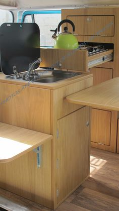 Kustom Interiors: covered sink and retractable stove, made for campers
