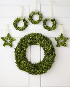 Deck the walls or windows with a single boxwood wreath, or combine them all for a dramatic wreath collage. Each is a study in understated elegance, with endless decorating options for years to come.