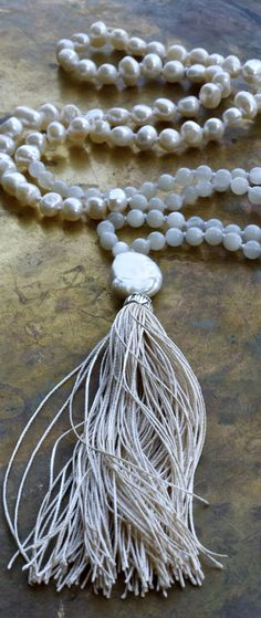 Gorgeous moonstone and pearl cream coloured mala necklace with a natural silk tassel at The Pillow Book