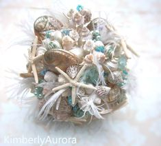DIY Wedding Centerpieces, information number 5422713936 - Delightful pointer to create a most memorable and dazzling centerpiece. do it yourself wedding centerpieces decoration suggestions posted on this day 20181217 , Seashell Bouquet, Beaded Bouquet, Wedding Brooch Bouquets, Bridesmaid Bouquet, Beach Wedding Bouquets, Wedding Centerpieces, Diy Wedding, Wedding Ideas, Wedding Things