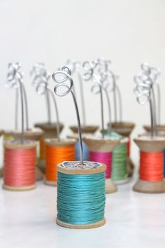 """Thread spool place card holder - if I ever do a """"tie the knot/knotted in love"""" bridal shower"""