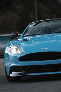 Aqua Blue Aston Martin Vanquish #sexy See more cars by signing up to carhoots.com today!