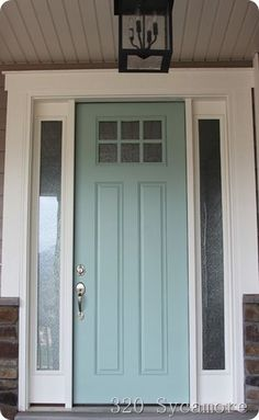 Fab front door. Color is Tidewater by Martha Stewart