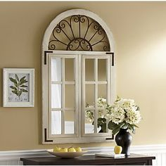 Window mirror framed white frames borders with French wrought rod iron above window arch archway arches black iron vintage antique scrolls fretwork foliage vines swirls designs patterns love modern contemporary Window Pane Decor, Window Pane Mirror, Faux Window, My Living Room, Home And Living, Entry Table With Mirror, Garden Windows, Love Your Home, Arched Windows