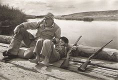 Author - Robert Capa - Ernest Hemingway and his son Gregory. Sun Valley, October 1941.