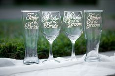 """Mother of Bride Wine Glass, Mother of Groom Wine Glass, Father of Bride Beer Glass, Father of Groom Beer Glass, Hand Engraved - Set of 4 - Choose from Wine, Pilsner, Pint or Whisky Glasses. These four matching glasses work together to represent the joining of your two families. Each glass is hand-engraved with elegant font that reads """"Mother of the Bride"""", """"Mother of the Groom"""", """"Father of the Bride"""" and """"Father of the Groom"""". The M in the word """"Mother"""" is flourished with a calligraphic..."""